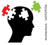Stock photo head with two piece of missing puzzles abstract editable design with black head and green and res 165529556