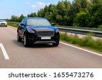 Black Suv Speeding On Fast Roa...