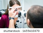 Attentive optometrist examining ...