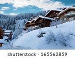 ski resort with winter chalets  ...   Shutterstock . vector #165562859