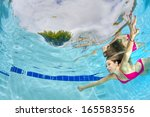 young sexy woman swimming... | Shutterstock . vector #165583556