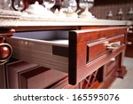 Stock photo wooden cupboard with opened empty drawer 165595076