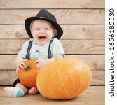 Baby In Black Hat With Pumpkins ...