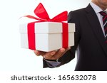 A Businessman Offering A Gift...
