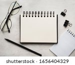 Small photo of Secretaries Day and Admin Day. Greeting card. Close-up, view from above, wooden surface. Concept of preparation for a professional holiday. Congratulations for relatives, friends and colleagues.