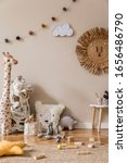 Small photo of Stylish scandinavian interior of child room with natural toys, hanging decoration, design furniture, plush animals, teddy bears and accessories. Beige walls. Interior design of kid room. Template.