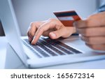 close up of a man shopping... | Shutterstock . vector #165672314