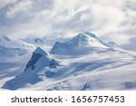 Top of mountain range with snow and ice near South Pole in Antarctica