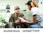 Young Military Man Talking To...