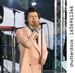 Small photo of New York, NY - February 26, 2020: Singer Harry Styles performs on stage during Citi Concert Series on NBC TODAY SHOW at Rockefeller Plaza