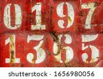 Numbers On An Old Rusty Metal...