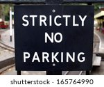 strictly no parking sign | Shutterstock . vector #165764990