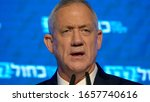 """Small photo of TEL AVIV, ISRAEL, April 9,2019 The Israeli prime minister candidate, """"Benny"""" Gantz, giving a speech during an election rally of his party - Blue and White in Rokach Tel Aviv"""