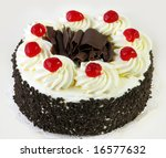 Black forest cake, topped with whipped cream and cherries. - stock photo