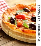 italian pizza with olives and... | Shutterstock . vector #165782378