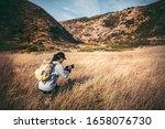 Female Photographer Hiking On...