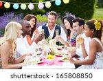 group of friends enjoying... | Shutterstock . vector #165808850