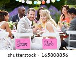 Bride And Groom Enjoying Meal...