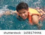 young man swimming in water    Shutterstock . vector #1658174446