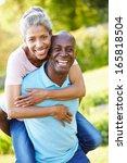 mature man giving woman...   Shutterstock . vector #165818504