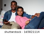 couple sitting on sofa watching ... | Shutterstock . vector #165821114
