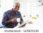 african american man using... | Shutterstock . vector #165823130