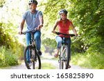 couple on cycle ride in... | Shutterstock . vector #165825890