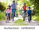 family on cycle ride in... | Shutterstock . vector #165826010