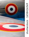 Small photo of Cockade of France on the fuselage of a military air craft, french air force, world war symbol
