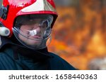 The Face Of A Fireman In A...