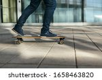Man Skateboarding In City With...
