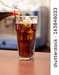 glass of cola with ice on the... | Shutterstock . vector #165848033