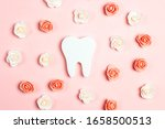 tooth surrounded by roses on a...   Shutterstock . vector #1658500513