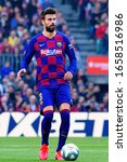 Small photo of BARCELONA - FEB 15: Gerard Pique plays at the La Liga match between FC Barcelona and Getafe CF at the Camp Nou Stadium on February 15, 2020 in Barcelona, Spain.