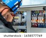 A engineer repairing electrical ...
