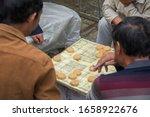 """Chinese Men Playing """"xiangqi"""" ..."""