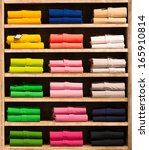 various color shirts at shelf... | Shutterstock . vector #165910814