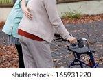 nurse helping elder person to... | Shutterstock . vector #165931220