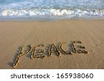 Peace Word Drawn On The Beach