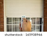 hand pressing a remote control... | Shutterstock . vector #165938966