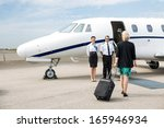 rear view of businesswoman with ... | Shutterstock . vector #165946934