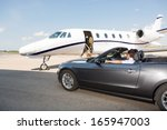 pilot in convertible parked... | Shutterstock . vector #165947003