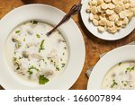 Small photo of Homemade Organic Oyster Stew with Crackers and Parsley