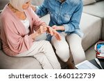 Elderly Woman Telling Family...