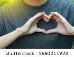 Hands Forming Heart Shape With...