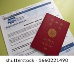 Small photo of Tokyo/Japan - March 22, 2018 - Japanese Passport and ESTA application status printed on paper. Authorization Approved.