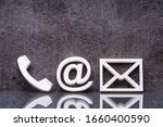 Small photo of Various Contact Us Methods. White Phone, Email And Post Icons