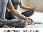 Small photo of Yoga session process meditation practice close up focus on male fingers folded in mudra symbol. Concept of clarity of mind, improve inner balance, healthy lifestyle, serenity, internal calmness state