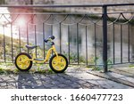 Children Yellow Bicycle Parked...