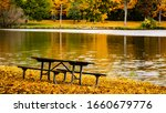 Picnic Table At Park In Autumn...